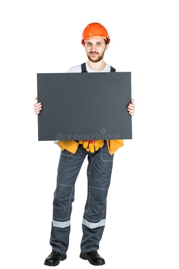 一名男性建筑工人的全长画象有白色的 免版税库存图片