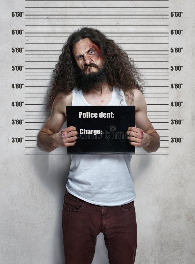 一名皮包骨头的罪犯的滑稽的画象 库存照片
