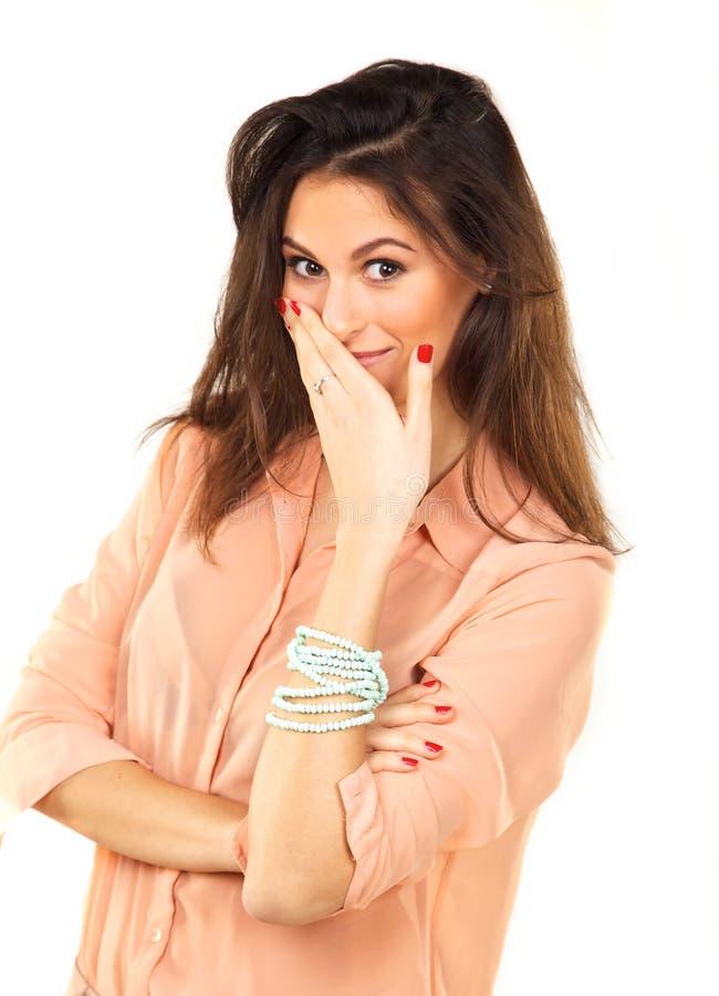 美丽的妇女用手盖嘴 图库摄影