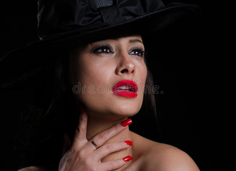 帽子的美丽,时髦的妇女 免版税库存照片