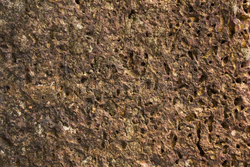 一块灰色红色多孔火山的石头 自然毛面纹理 库存图片