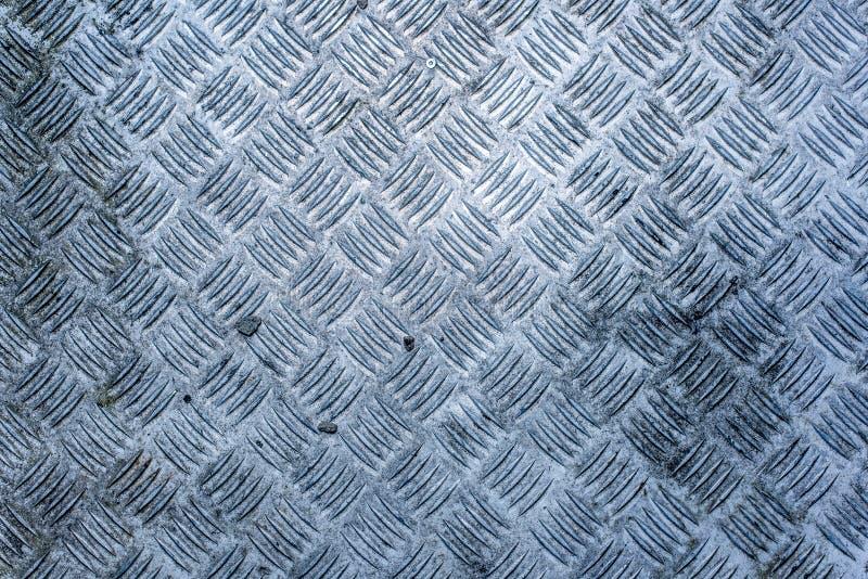 一块肮脏,破旧和被风化的金刚石板材 免版税库存图片