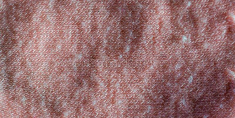 一块软的桃红色棉织物的宏观特写镜头,衣物材料,织地不很细背景 免版税库存照片