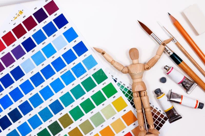 一套为创造性的书刊上的图片的工具与摘要色板显示指南 免版税库存图片