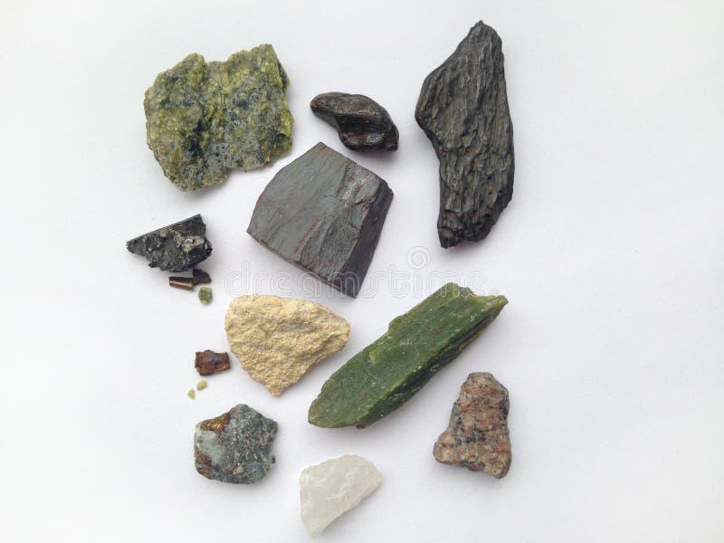 一套在白色背景的不同的石头 库存图片