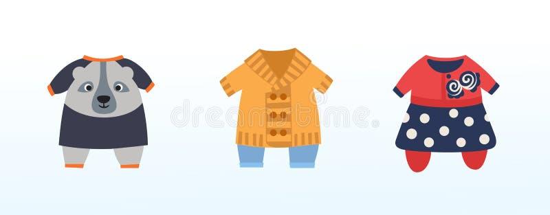 一套女孩和男孩的儿童的欢乐衣物 免版税库存照片