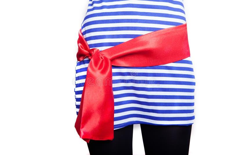 一套海盗服装的女孩为假日,隔绝在白色背景 库存照片
