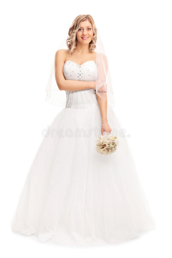 一套白色婚礼礼服的美丽的妇女 免版税库存图片