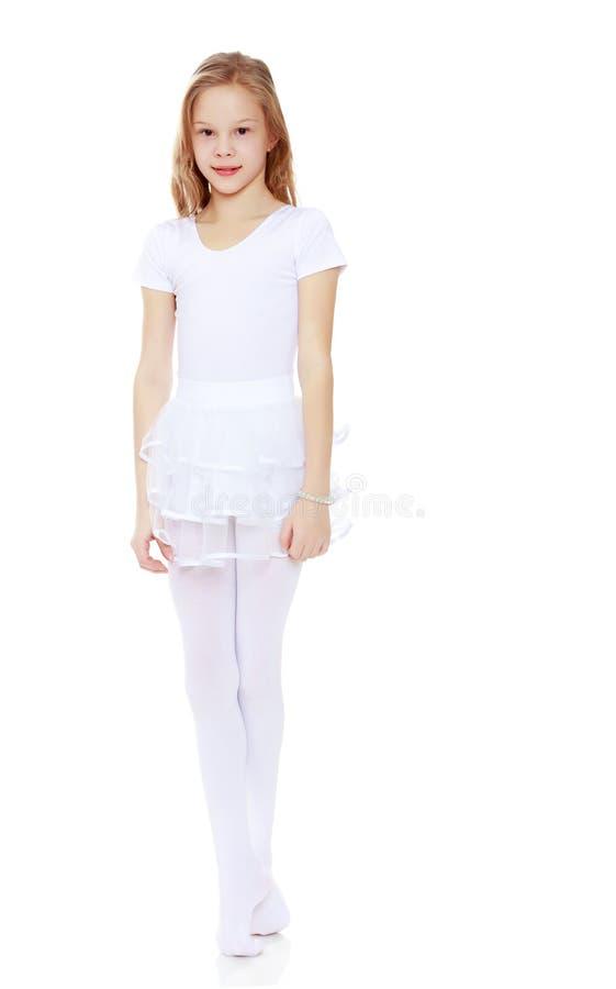 一套白色衣服的小体操运动员 库存照片
