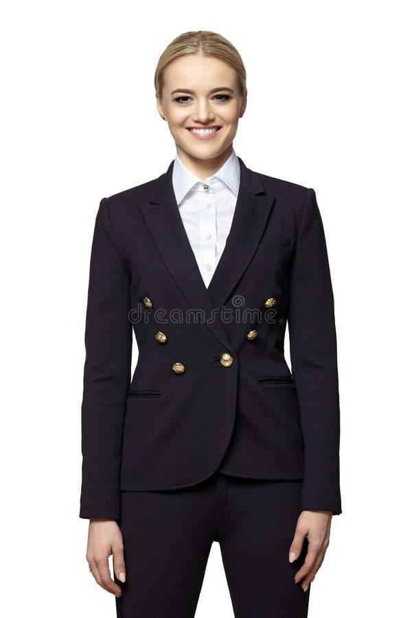 一套黑暗的西装的快乐的年轻女人 库存照片