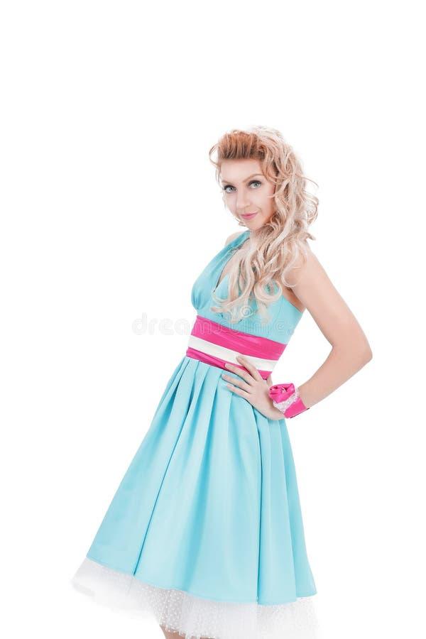 一年轻女人的画象明亮的蓝色礼服的仿照画报样式 库存图片