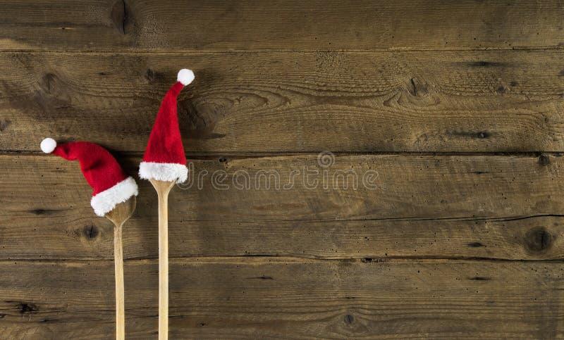 一张菜单卡片的滑稽的木圣诞节背景与木sp 库存照片