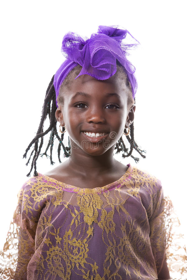 一愉快小女孩微笑的美丽的画象 查出 库存照片