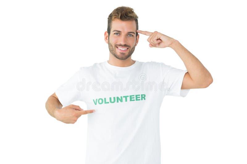 一愉快的男性志愿指向的画象他自己 库存照片
