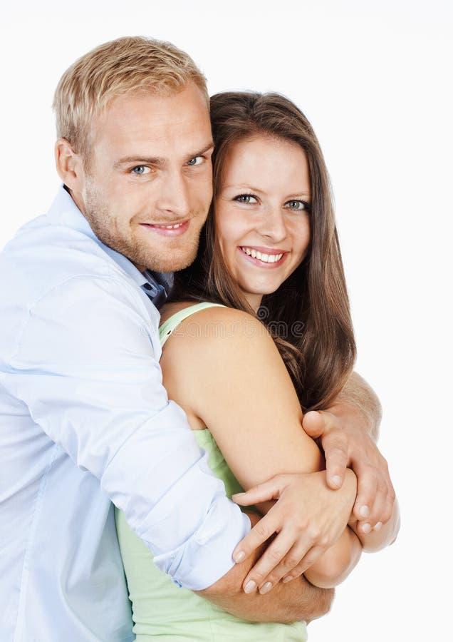 一愉快年轻夫妇微笑的画象 免版税库存图片