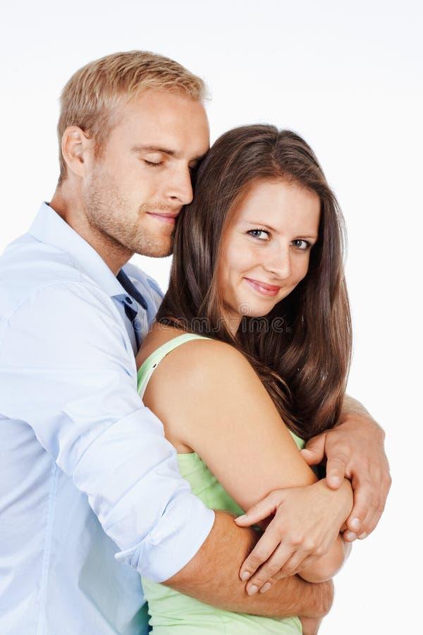 一愉快年轻夫妇微笑的画象 库存图片