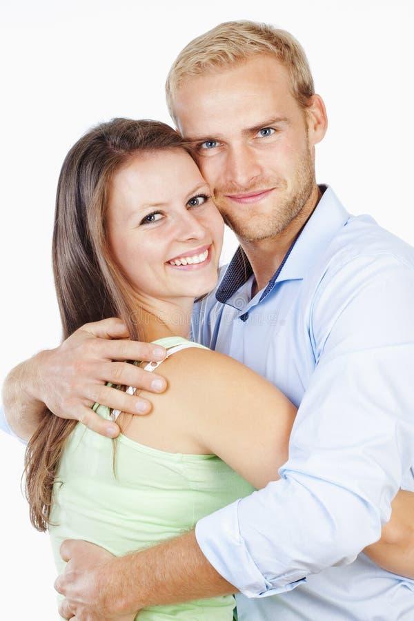 一愉快年轻夫妇微笑的画象 库存照片