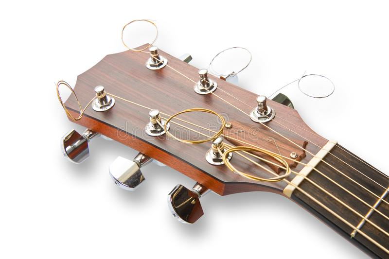 一把木声学吉他的细节有串钢的 免版税库存图片