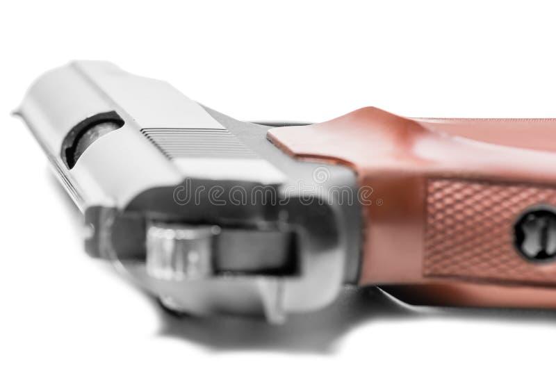 一把瓦斯手枪的特写镜头在白色的 免版税库存照片