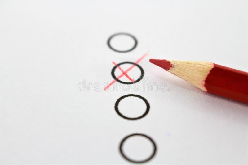 一支红色铅笔和查询表的概念图象 免版税库存图片