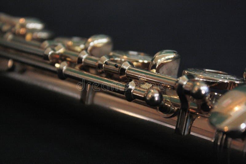 一支长笛的细节在黑背景的 免版税库存图片