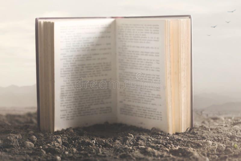 一本大书的超现实的图象开放在自然中间 库存照片