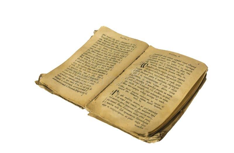 一本老俄国书的低俗新闻在古老俄语的白色背景的 免版税库存图片