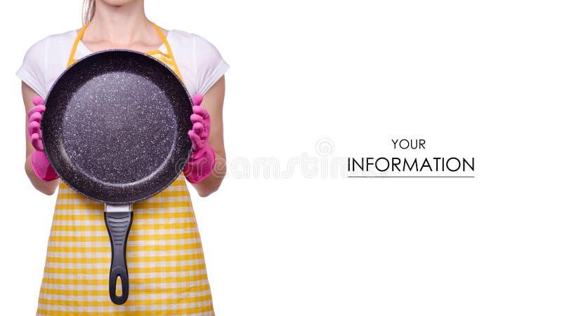 一条围裙的妇女在清洁手套的手上煎锅样式 免版税库存照片