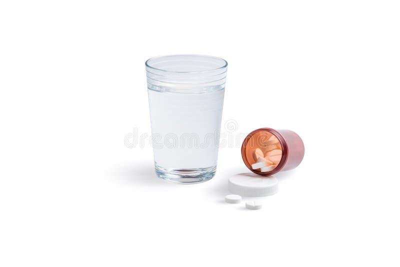 一杯与止痛药的水 库存图片