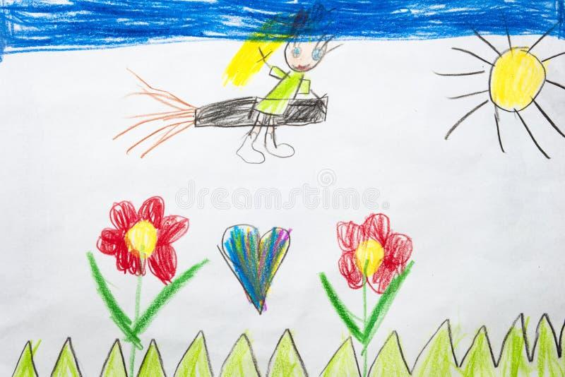 一次小的巫婆飞行的五颜六色的孩子` s图画在帚柄的 免版税库存照片
