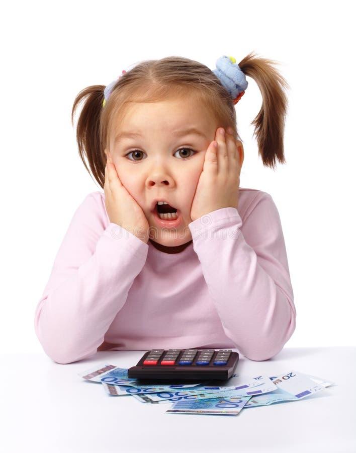 一点做的货币作用冲击的表面女孩 免版税库存照片
