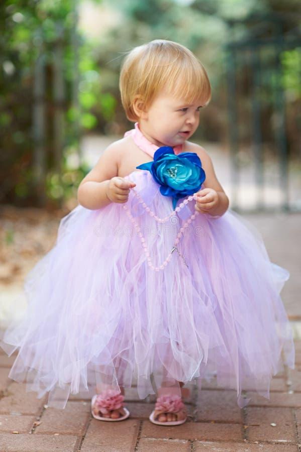 一点有小珠的俏丽的女孩 库存照片