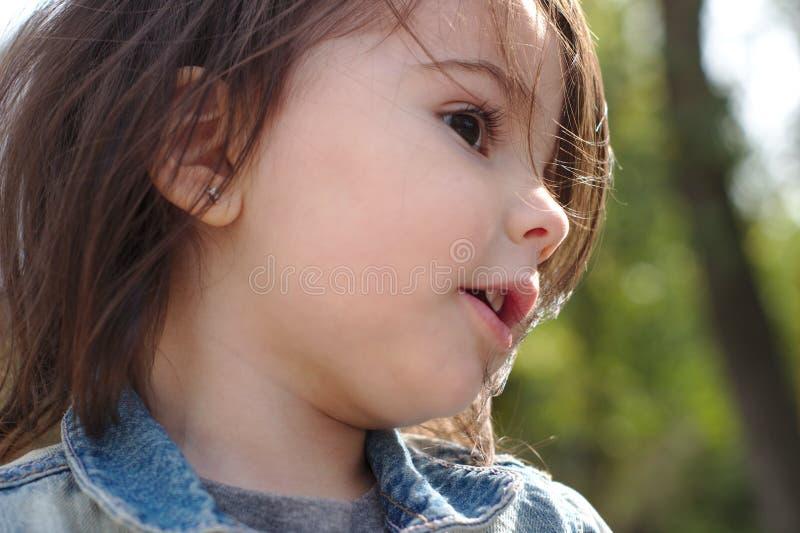 一点逗人喜爱的情感女孩特写镜头画象有猪尾的在牛仔布夹克 图库摄影