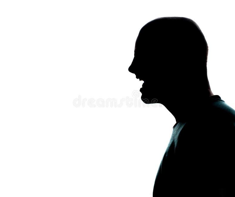 一白种人人画象剪影外形尖叫恼怒在白色背景的演播室 库存图片