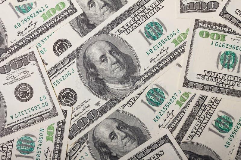一百元钞票堆 免版税库存图片