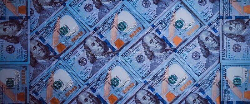 一百元钞票的背景 蓝色设计 免版税库存照片