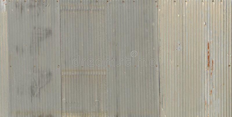 一种生锈的波状钢金属,锌墙壁,背景 库存图片