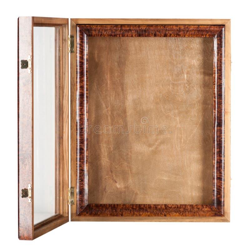 一种黑褐色自然颜色是一个空的被涂清漆的木制框架 免版税库存照片