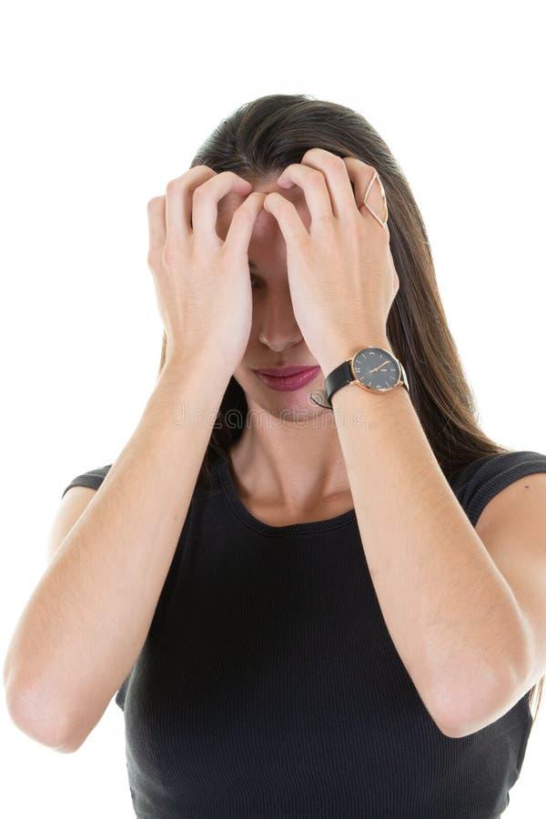一美丽的年轻女人有头疼用在头骨的手 免版税库存图片