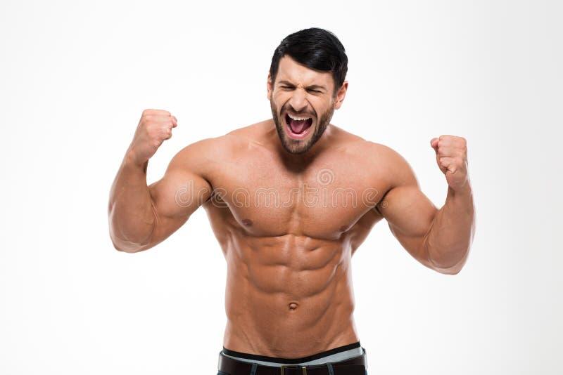 一英俊肌肉人呼喊的画象 免版税库存图片