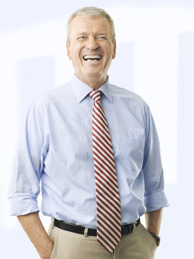 一资深商人微笑的画象 免版税库存图片