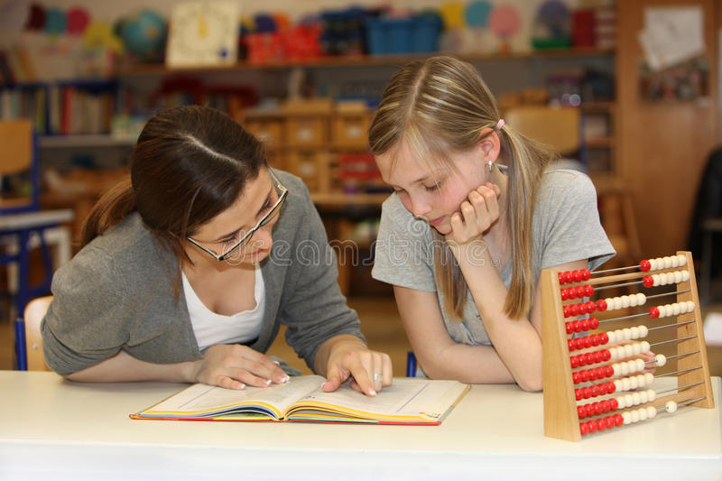 一起了解的教师和的学员 库存照片