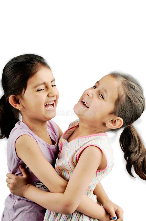 一起使用女孩印第安的孩子 免版税库存照片