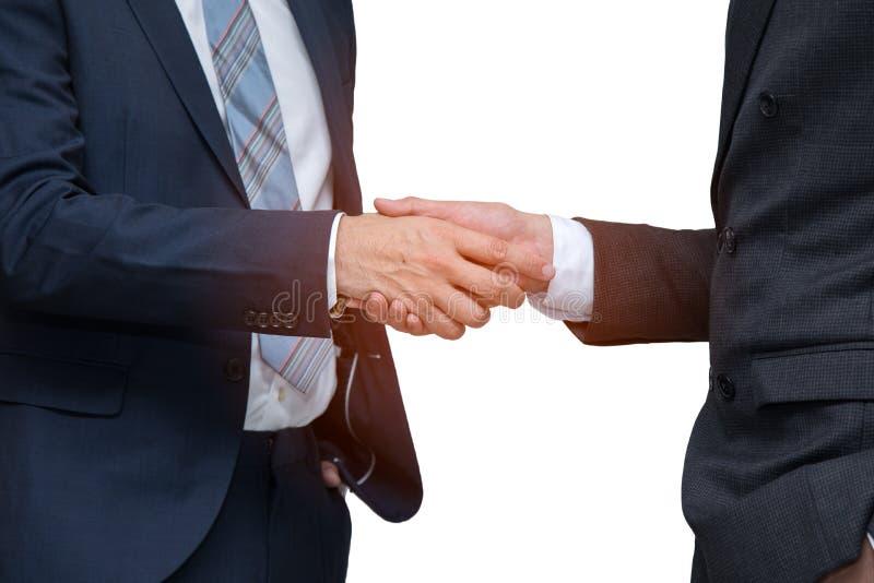 一起握手的两个商人在白色背景 图库摄影