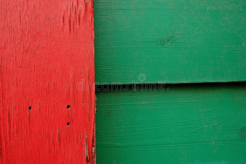 一起砰地作声绿色和红色的板 库存照片