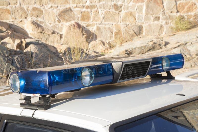 一辆老警车的警报器和光 库存照片