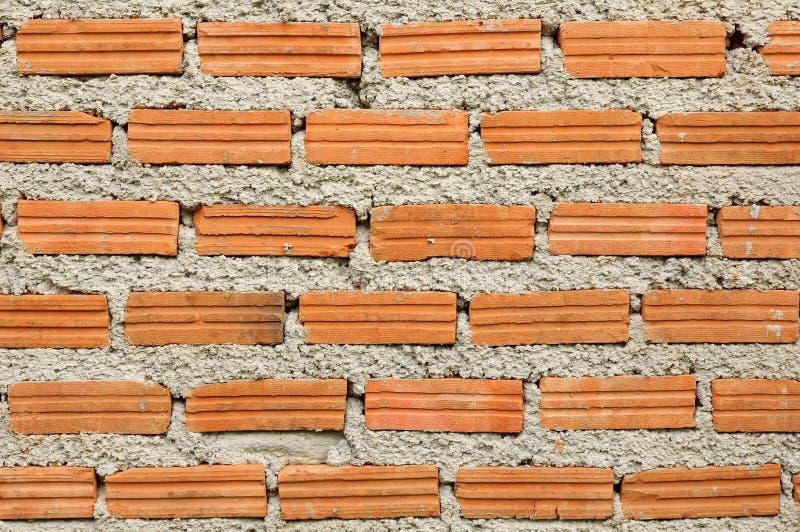 一部分的橙色砖墙 库存图片