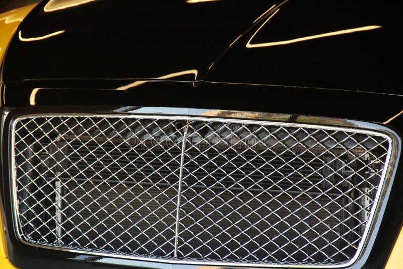 一部分的黑汽车关闭 汽车格栅 免版税图库摄影