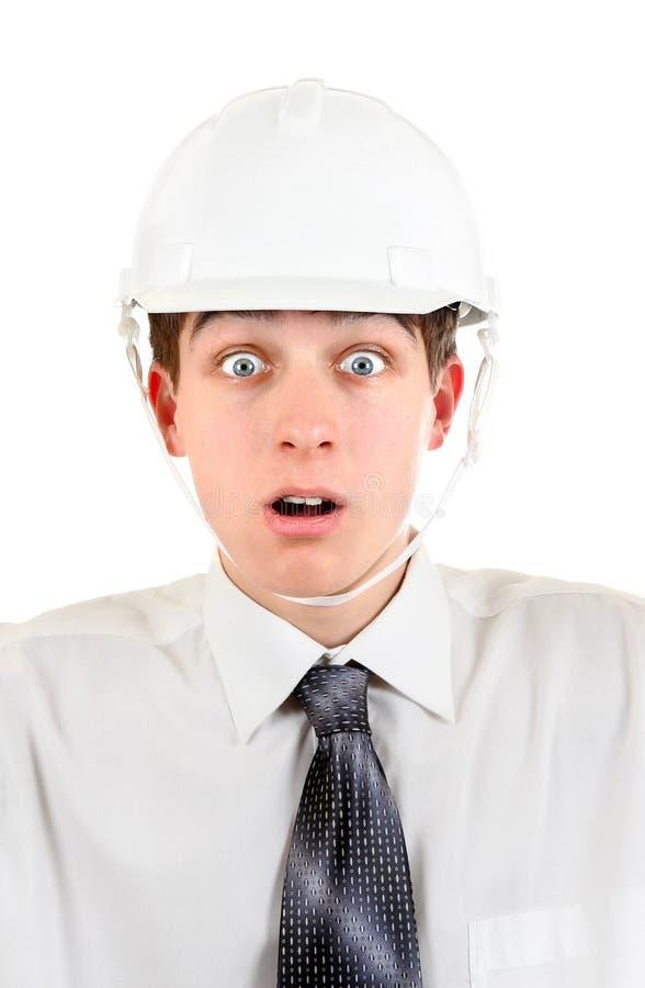 一顶安全帽的年轻人 免版税库存照片