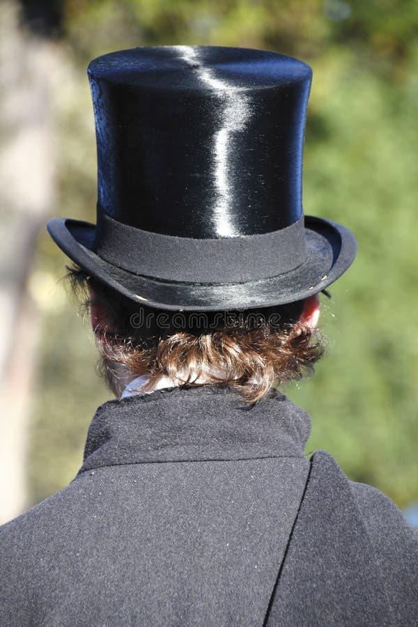 一顶高顶丝质礼帽的人 图库摄影